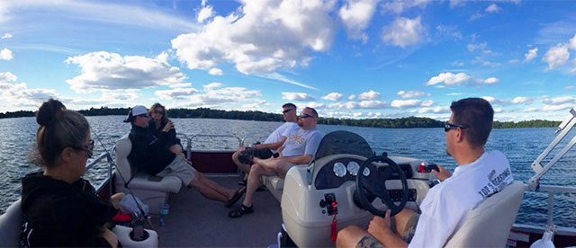 Group of people hanging out on a boat in Minnesota